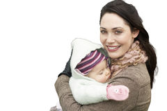 Portrait of beautiful mother holding baby girl against white background Royalty Free Stock Photos