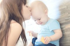 Portrait of beautiful mother kissing her child girl royalty free stock photography