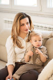 Portrait of beautiful mother and little son sitting in her lap. Family values Royalty Free Stock Photography