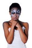 Portrait of beautiful mulatto girl with body art. On her face isolated on a white background Royalty Free Stock Photography