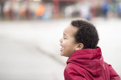 Portrait of a beautiful multi racial happy boy laughing Royalty Free Stock Photo