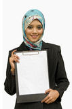 Portrait of a beautiful Muslim. Woman holding a white paper, ioslated on white background Stock Images