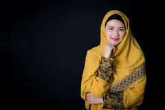 Portrait of beautiful muslim asian woman over black background. royalty free stock photography