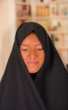 Portrait of a beautiful muslim girl wearing a hijab in a blurred background.  Stock Photography