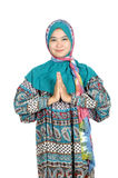 Portrait of a beautiful muslim woman. A beautiful muslim woman greetings with his palms pressed isolated on white background Royalty Free Stock Images