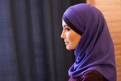 Portrait of a beautiful Muslim woman in profile, traditional covered head Royalty Free Stock Photography