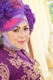 Portrait of a beautiful muslim woman. Wearing a purple moslem wear modification Stock Photography