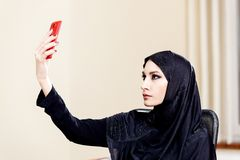 Portrait of a beautiful Muslim woman who is doing a photo Stock Photography