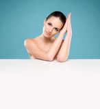 Portrait of a beautiful naked woman with a white banner Stock Photo