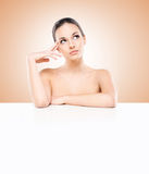 Portrait of a beautiful naked woman with a white banner Royalty Free Stock Photography