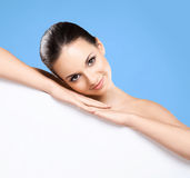 Portrait of a beautiful naked woman with a white banner Stock Photography