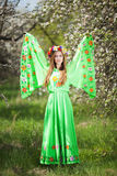 Portrait of beautiful natural woman in nice green dress in the garden of apple Royalty Free Stock Photo