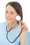 Portrait Of A Beautiful Natural Young Female Doctor Holding A Stethoscope Royalty Free Stock Photos