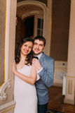 Portrait of beautiful newlywed pair embracinging in vintage victorian mansion interior Royalty Free Stock Photos