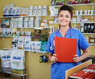 Portrait of beautiful nurse with folder at vet clinic. Stock Photography
