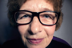 Portrait of a beautiful older woman with glasses Stock Image