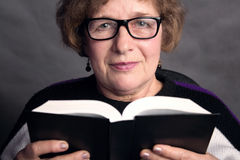 Portrait of a beautiful older woman with glasses Stock Photography