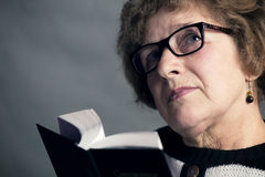 Portrait of a beautiful older woman with glasses Stock Images