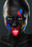 Portrait of a beautiful open-mouthed woman with black face Royalty Free Stock Photography