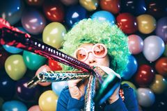 Portrait of beautiful party woman in wig and glasses Carneval. Portrait of beautiful party woman in wig and blasses Carneval royalty free stock photo