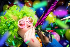 Portrait of beautiful party woman in wig and glasses Carneval. Portrait of beautiful party woman in wig and blasses Carneval royalty free stock image