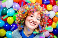 Portrait of beautiful party woman in wig and glasses Carneval.  royalty free stock photography