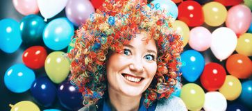 Portrait of beautiful party woman in wig and glasses Carneval.  royalty free stock image