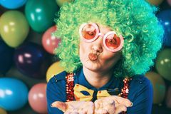 Portrait of beautiful party woman in wig and glasses Carneval.  royalty free stock photo