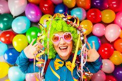 Portrait of beautiful party woman in wig and glasses Carneval.  stock photo
