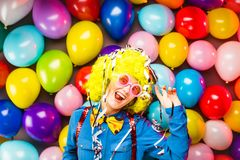 Portrait of beautiful party woman in wig and glasses Carneval. Portrait of beautiful party woman in wig and blasses Carneval stock image