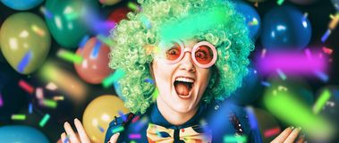 Portrait of beautiful party woman in wig and glasses Carneval.  stock photos