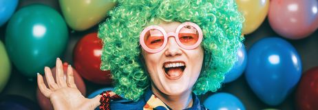 Portrait of beautiful party woman in wig and glasses Carneval.  stock images