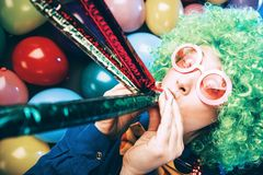 Portrait of beautiful party woman in wig and glasses Carneval.  stock photography