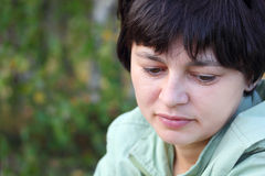 Portrait of a beautiful pensive woman Stock Images