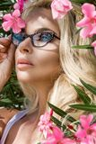 Portrait beautiful phenomenal stunning elegant sexy blonde model woman with perfect face wearing a glasses stands with elegant out Stock Image