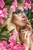 Portrait beautiful phenomenal stunning elegant sexy blonde model woman with perfect face wearing a glasses stands with elegant out Royalty Free Stock Photography
