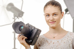 Portrait of beautiful photographer smiling with digital camera i Royalty Free Stock Photo