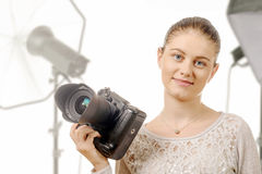 Portrait of beautiful photographer smiling with digital camera i Royalty Free Stock Image