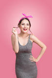 Portrait of beautiful pinup asian woman with vintage makeup and. Hairstyle. on pink background royalty free stock images