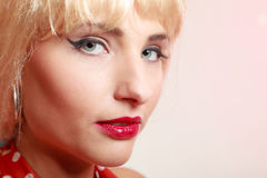 Portrait beautiful pinup girl in blond wig and retro makeup. Vintage. Stock Photos