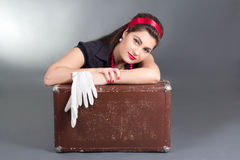 Portrait of beautiful pinup girl with retro suitcase Stock Image