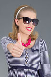 Beautiful pinup girl in sunglasses thumbs up Royalty Free Stock Photo