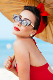 Portrait of beautiful pinup girl with umbrella Royalty Free Stock Image