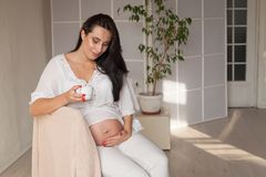 Room portrait of the beautiful pregnant woman before childbirth royalty free stock photos