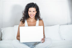 Portrait of beautiful pregnant woman using laptop Royalty Free Stock Photography