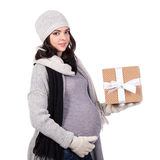 Portrait of beautiful pregnant woman in warm winter clothes with royalty free stock image