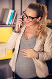Pregnant woman at work stock photos