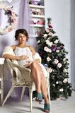 Portrait of the beautiful pregnant young woman near a Christmas tree Royalty Free Stock Photo