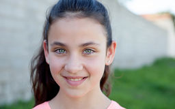Portrait of a beautiful preteen girl with blue eyes. Outside Royalty Free Stock Photos