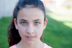 Portrait of a beautiful preteen girl with blue eyes. Outside Stock Photos